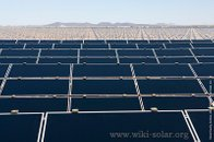 First Solar modules march across the desert as construction of the Agua Caliente Solar Project progresses